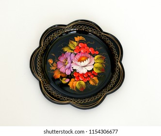 MOSCOW, RUSSIA - AUGUST 11, 2018: Zhostovo painting, old Russian folk handicraft of painting on metal trays, which still exists in village of Zhostovo. Tray with flowers and berries of mountain ash
