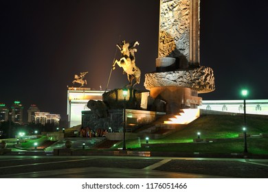 MOSCOW, RUSSIA - August 11, 2018: Night view of the bottom part of the Main Victory Monument decorated with old-style street lights at Square of Victors on Poklannaya Hill, Victory Memorial Complex