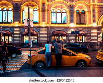 MOSCOW, RUSSIA - AUGUST 11, 2018: Yellow taxi parked near Gum on red square