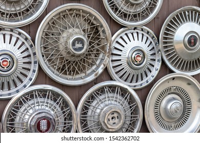 Moscow, Russia - August 11, 2019: Wall collection of vintage rusty automobile hubcaps of retro cars.