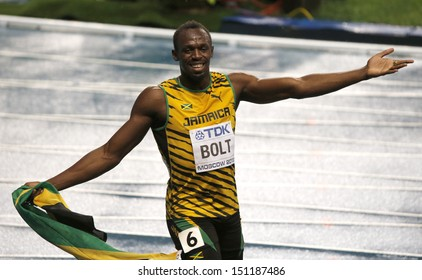 MOSCOW, RUSSIA - AUGUST 11: Usain Bolt celebrates his win at the World Athletics Championships on August 11, 2013 in Moscow