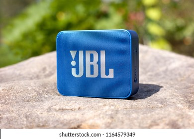 Moscow, Russia - August 12, 2018: Bluetooth speaker JBL Go 2 standing on stone.