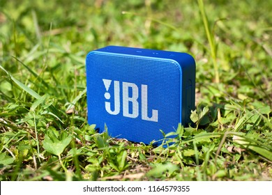 Moscow, Russia - August 12, 2018: Bluetooth speaker JBL Go 2 standing on the grass.