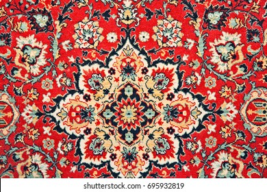 MOSCOW, RUSSIA - AUGUST 13, 2017: Details of a colorful ornamented Persian rug or carpet. The carpet decorates Faces and Laces street culture and fashion open air festival.