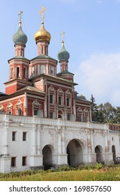 MOSCOW, RUSSIA - AUGUST 14, 2010: Orthodox Cathedral of the Holy Virgin Protection over the Southern gate of Novodevichy Convent. Since 2004, the Convent is a UNESCO World Heritage Site