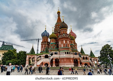 MOSCOW, RUSSIA - AUGUST 14, 2016 -  Monument to Minin and Pozharsky on the Red Square in Moscow Russia. Saint Basil's Cathedral on the background.