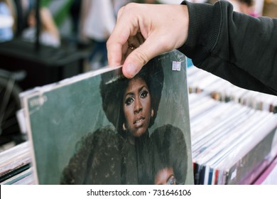 Moscow, Russia - August 14, 2016: Man choosing vinyl at the vinyl market.