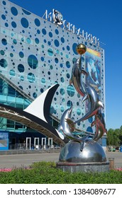 "Moscow, Russia - August 14, 2018: Sculptural composition and building of the center for Oceanography and marine biology ""Moskvarium"" at VDNH"