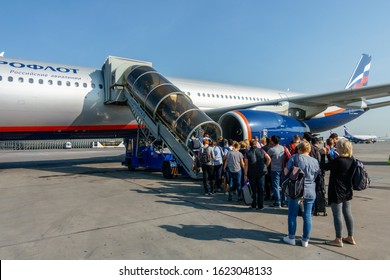 Moscow, Russia - August 15, 2019: Passengers boarding to Aeroflot company aircraft at Sheremetyevo airport