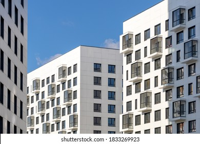 Moscow, Russia - August 15, 2020. Multi-storey residential buildings with balconies. Laconic design in light colors. Modern apartments
