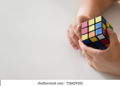 Moscow, Russia, August 16 2017: Rubik's cube in child's hands, closeup.Boy holding Rubik's cube and playing with it.