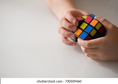 Moscow, Russia, August 16 2017: Rubik's cube in child's hands, closeup.. Boy holding Rubik's cube and playing with it.