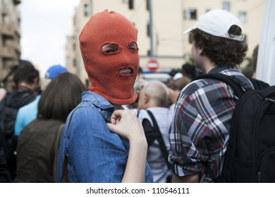 MOSCOW , RUSSIA - AUGUST 17. Protestant wears balaclava Pussy Riot , gathered outside court to protest against the verdict and support the members of  Pussy Riot feminist punk band on August 17, 2012, Moscow