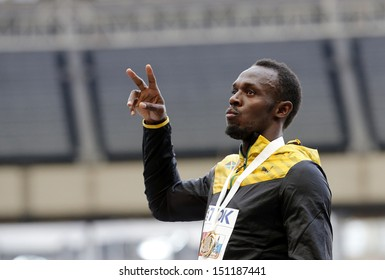 MOSCOW, RUSSIA - AUGUST 17: Usain Bolt celebrates his win at the World Athletics Championships on August 17, 2013 in Moscow