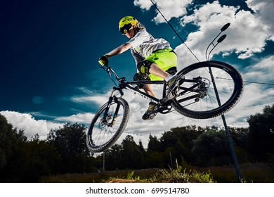 Moscow, Russia - August 18, 2017: Jump and fly on a mountain bike. Rider in action at mountain bike sport. Cool athlete cyclist on a bike. MTB biking.