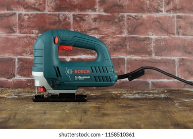 MOSCOW, RUSSIA, AUGUST 18, 2018. electric jig saw Bosch Professional GST 8000 E on a wooden table against a brick wall.