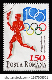 MOSCOW, RUSSIA - AUGUST 18, 2018: A stamp printed in Romania shows Torchbearer & jubilee badge, International Olympic Committee (IOC), Centenary serie, circa 1994