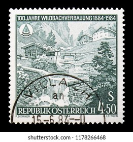 MOSCOW, RUSSIA - AUGUST 18, 2018: A stamp printed in Austria shows Latches in a mountain torrent, Torrent Control serie, circa 1984