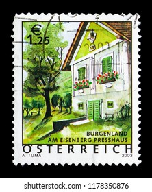 MOSCOW, RUSSIA - AUGUST 18, 2018: A stamp printed in Austria shows Winepress House at Eisenberg (Burgenland), Holiday country Austria serie, circa 2003