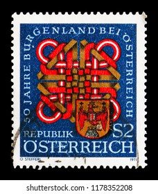 MOSCOW, RUSSIA - AUGUST 18, 2018: A stamp printed in Austria shows Coat of arms of Burgenland & wattle, serie, circa 1971