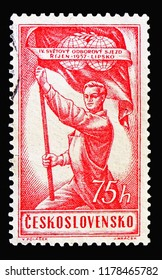 MOSCOW, RUSSIA - AUGUST 18, 2018: A stamp printed in Czechoslovakia shows Man hold flag, Trade Unions, 4th World Congress, serie, circa 1957