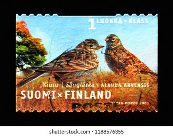MOSCOW, RUSSIA - AUGUST 18, 2018: A stamp printed in Finland shows Eurasian Skylark (Alauda arvensis), Regional birds serie, circa 2003