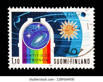 MOSCOW, RUSSIA - AUGUST 18, 2018: A stamp printed in Finland shows Observatory, solar system, 100 Years Observatory of Helsinki University serie, circa 1984