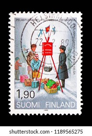 MOSCOW, RUSSIA - AUGUST 18, 2018: A stamp printed in Finland shows Christmas collecting by the Salvation Army, 100 Years Salvation Army in Finland serie, circa 1989