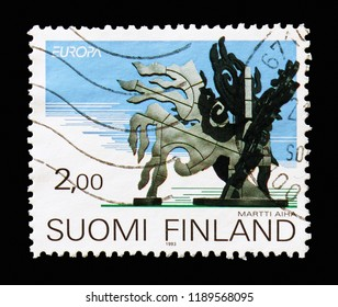 """MOSCOW, RUSSIA - AUGUST 18, 2018: A stamp printed in Finland shows """"Rumba"""", sculpture by Martti Aiha (1952-), Europa (C.E.P.T.) 1993 - Modern Art serie, circa 1993"""