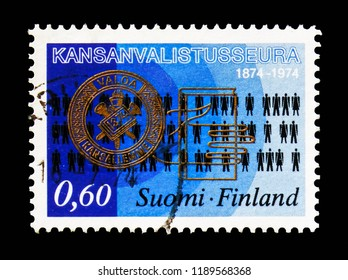 MOSCOW, RUSSIA - AUGUST 18, 2018: A stamp printed in Finland shows Badge of the Society, Symbols, 100 Years Society for Popular Education serie, circa 1974