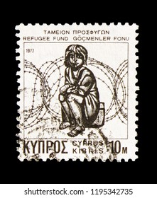 MOSCOW, RUSSIA - AUGUST 18, 2018: A stamp printed in Cyprus shows Obligatory Tax Refugee Fund, serie, circa 1977