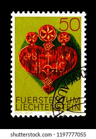MOSCOW, RUSSIA - AUGUST 18, 2018: A stamp printed in Liechtenstein shows Artefacts from the Alps, Alpine Dairy farming implements serie, circa 1980