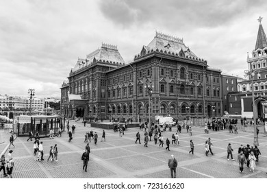 MOSCOW, RUSSIA - AUGUST 19, 2017: Manege Square (Ploshchad Manezhnaya) and Revolution Square (Ploshchad Revolyutsii) with the Historical Museum and unidentified tourists. Black and white image.