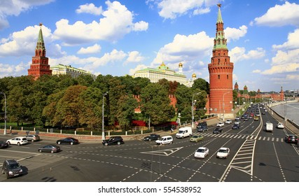 MOSCOW, RUSSIA - AUGUST 20, 2014: Cars are moving on the Kremlin embankment in front of the Moscow Kremlin is the oldest part of the city.