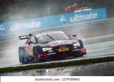 Moscow, Russia - August 20, 2016: Mattias Ekstrom (Audi Sport Team Abt Sportsline) driving a Audi RS5 DTM during DTM rain race at Moscow Raceway