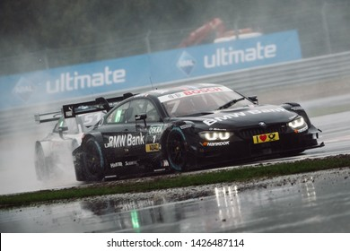 Moscow, Russia - August 20, 2016: Bruno Spengler (BMW Team MTEK) driving a BMW M4 DTM during DTM rain race at Moscow Raceway