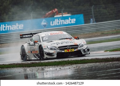 Moscow, Russia - August 20, 2016: Robert Wickens (Mercedes-AMG DTM Team HWA) driving a Mercedes-AMG C63 DTM during DTM rain race at Moscow Raceway