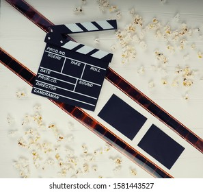 MOSCOW, RUSSIA - AUGUST 2017: film and popcorn concept the industry, movie, Golden globe Oscar, best actress, producer, Director. Clapperboard copy space, film industry.