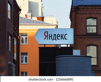 Moscow, Russia - August, 2018 Yandex company headquarters in Moscow, Lev Tolstoy Street, 16. A sign with the Yandex company logo in front entering of the building