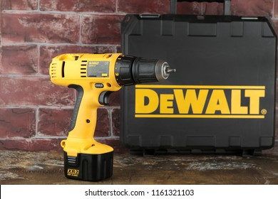 MOSCOW, RUSSIA, AUGUST 21, 2018. 12V Cordless Drill/Drivers DeWalt DW912 on a wooden table against a brick wall.