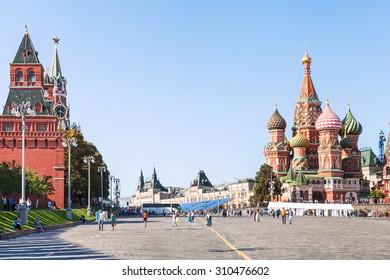 MOSCOW, RUSSIA - AUGUST 22, 2015: tourists on Vasilevsky Descent, Spasskaya, Nabatnaya, Konstantino-Eleninskaya Towers of Moscow Kremlin, Saint Basil Cathedral on Red Square of Moscow Kremlin