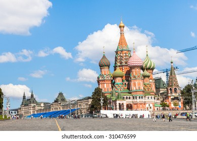 MOSCOW, RUSSIA - AUGUST 23, 2015: people on Vasilevsky Descent of Red Square in Moscow and Saint Basil Cathedral in sunny summer day