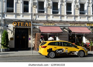 MOSCOW, RUSSIA - AUGUST 24, 2018: Yellow taxi at the hotel on Rozhdestvensky Boulevard in Moscow