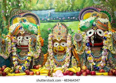 Moscow, Russia - August 25, 2016. Indian deities on the altar: Lord Jagannath with his elder brother Balabhadra and sister Subhadra.