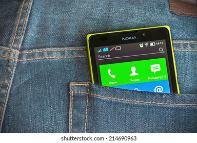 Moscow, Russia - August 26, 2014: Nokia XL smartphone in the pocket of jeans. Nokia XL new smartphone running on the Android platform with a 2-core processor Qualcomm.