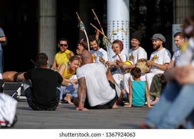 Moscow, Russia, August 26, 2018: a group of musicians on the street playing musical instruments berimbau, accompanying the martial art of capoeira in front of the Central house of artists