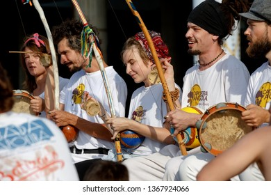 Moscow, Russia, August 26, 2018: young people play berimbau musical instruments, accompanying the martial art of Capoeira in front of the Central House of Artists