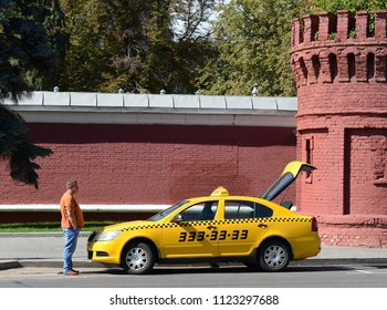 MOSCOW, RUSSIA AUGUST 27, 2016: The taxi driver is waiting for passengers with a raised door of the Luggage compartment at the Novodevichy cemetery in Moscow.