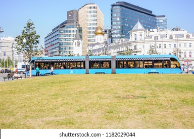 """MOSCOW, RUSSIA - August 27, 2018: Tram 71-931M """"Vityaz-M""""on Tverskaya Zastava square, an old house with a turret, the old believer Church of St. Nicholas and the business center """"White square"""""""