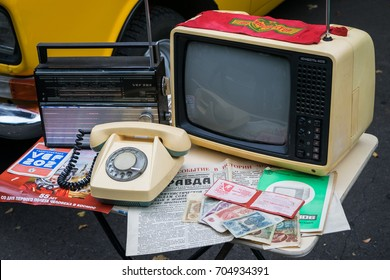 MOSCOW, RUSSIA - AUGUST 28, 2017: Retro  things from Soviet time: old rotary telephone, black and white TV set, radio receiver, money, newspaper Pravda, certificate of Communist shock-worker